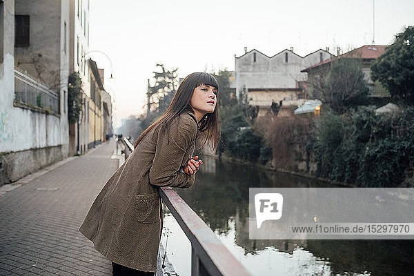 Woman relaxing by river  Milano  Lombardia  Italy