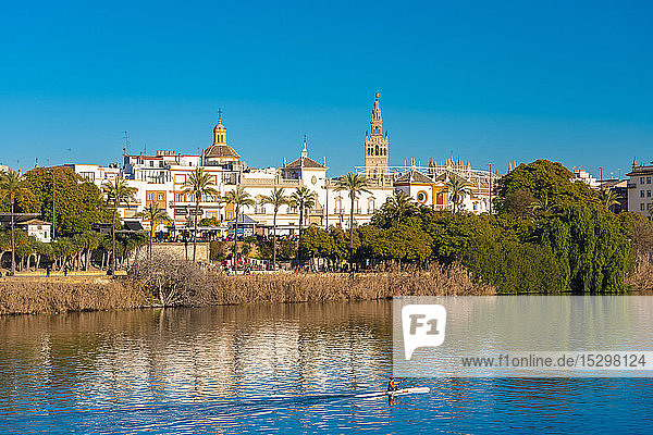 Cityscape with Guadalquivir river  Cathedral of Seville with La Giralda  Seville  Spain