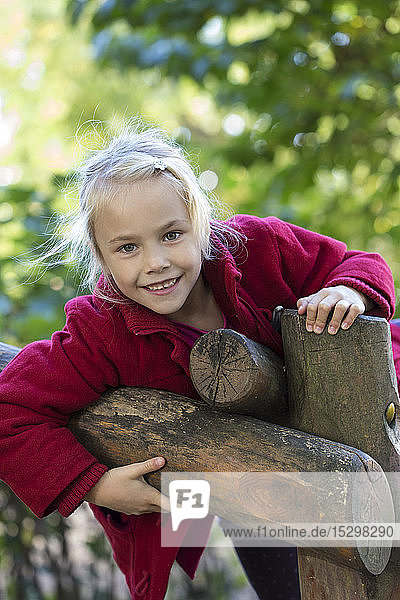 Portrait of smiling blond girl in autumn