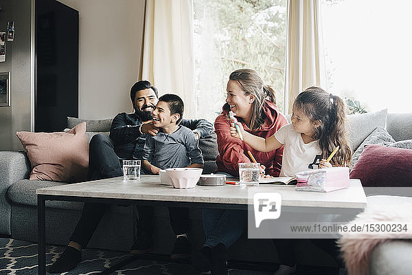 Happy family spending leisure time in living room