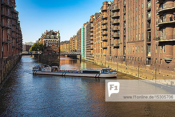 Tour boat at water castle  Speicherstadt  Hamburg  Germany