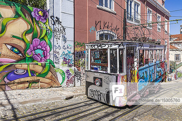 Portugal  Lisbon  Graffiti covered building and Gloria Funicular