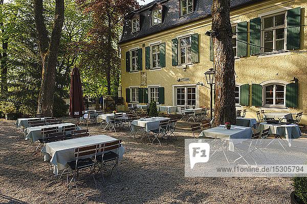 Germany  Upper Bavaria  Munich  Tables in garden ofGutshof Menterschwaige restaurant
