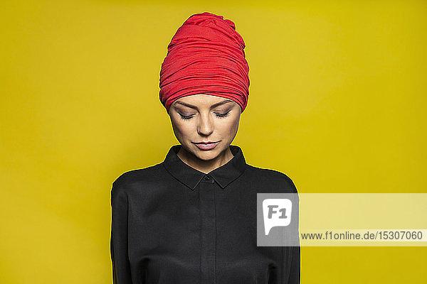 Portrait serene woman wearing headscarf