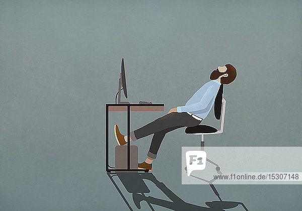 Tired businessman sleeping at desk