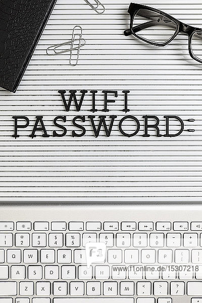 View form above 'Wifi Password' on desk above computer keyboard