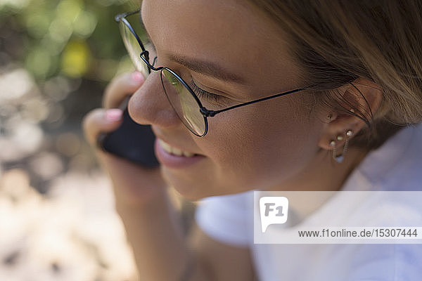 Young woman talking on smart phone
