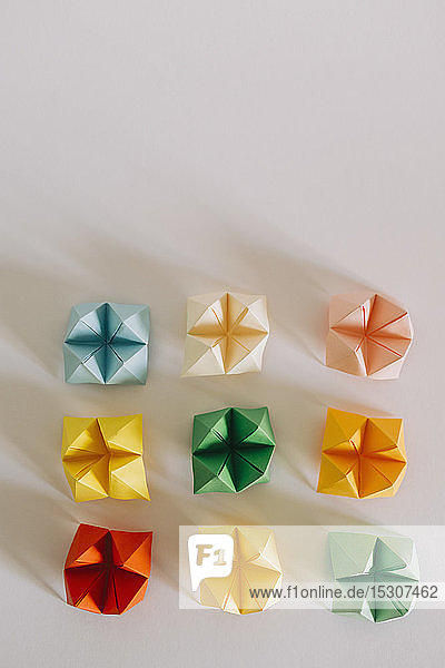 Multicolored origami fortune tellers on white background