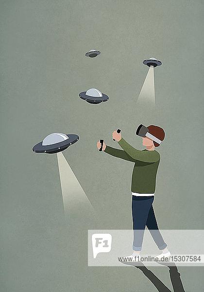 Junge spielt UFO-Videospiel mit Virtual-Reality-Simulatorbrille