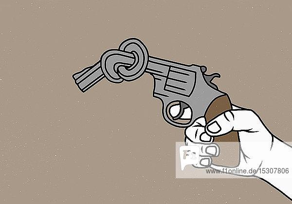 Mann hält verknotete Pistole