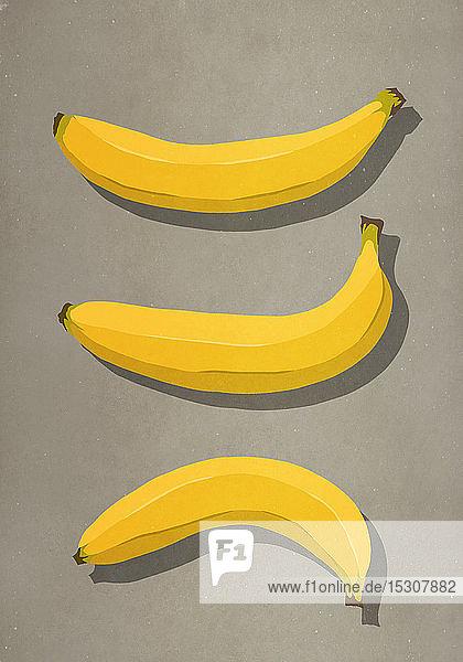 Gelbe Bananen auf braunem Hintergrund