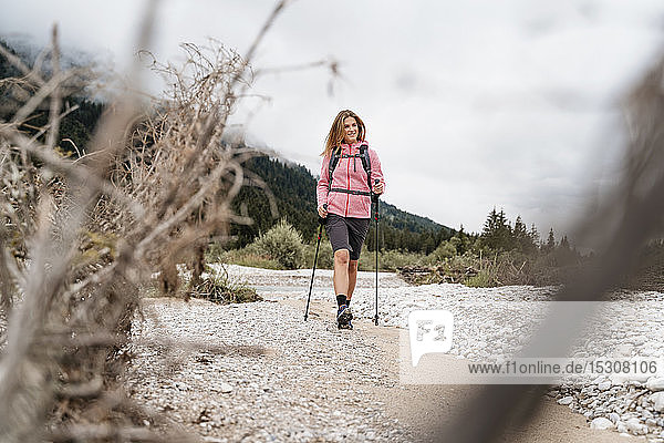 Young woman on a hiking trip at riverside  Vorderriss  Bavaria  Germany