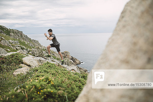 Trail runner in coastal landscape  Ferrol  Spain