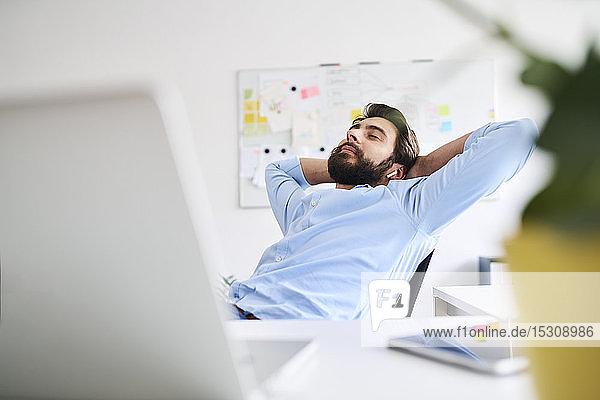 Businessman relaxing at a desk