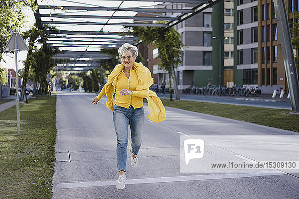 Happy mature woman jumping in the air