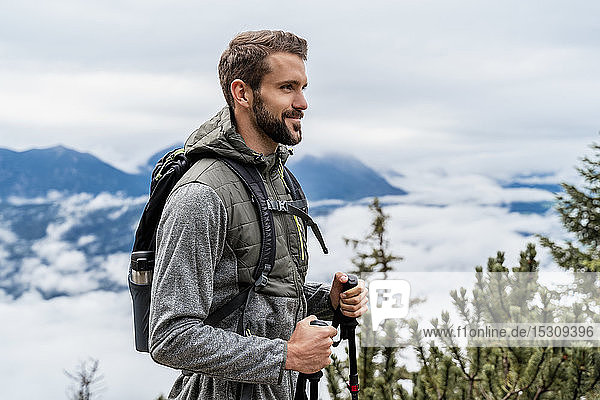 Confident young man on a hiking trip in the mountains  Herzogstand  Bavaria  Germany