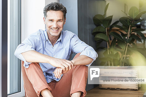 Mature man relaxing at home  smiling