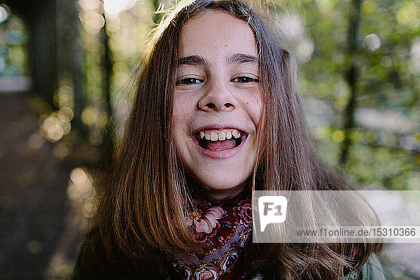Portrait of laughing young girl in a park