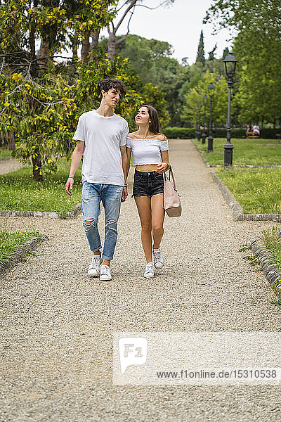 Young couple walking together in a park