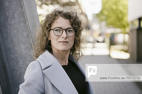Portrait of mature businesswoman with glasses outdoors