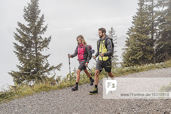 Young couple on a hiking trip in the mountains  Herzogstand  Bavaria  Germany