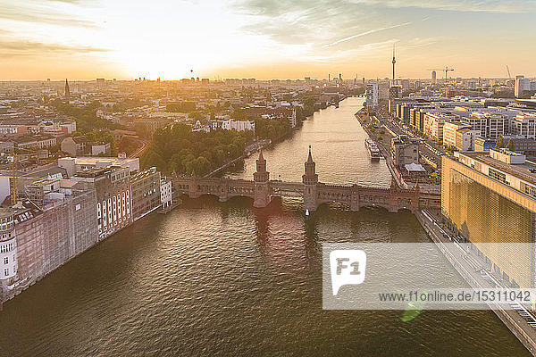 High angle view of Oberbaumbruecke bridge over river against sky during sunset