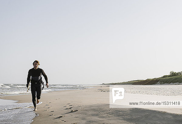 Surfer running at the beach