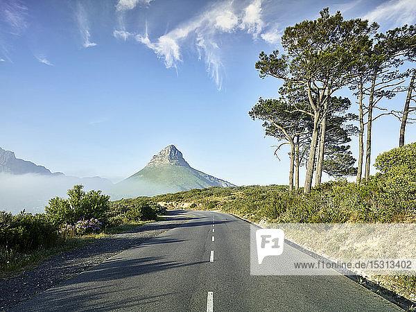 Empty asphalt road toward Lions Head mountain  Cape Town  South Africa