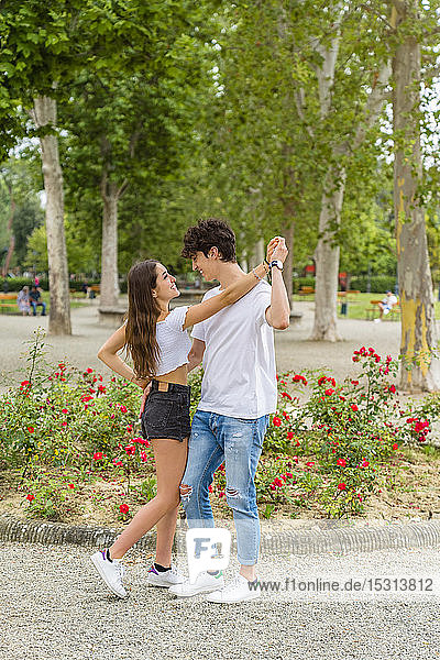 Young couple dancing in a park