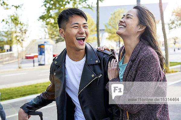 Happy tourist couple walking down the street in Barcelona  Spain