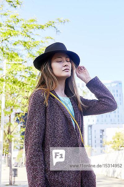 Dreamy woman wearing a hat  Barcelona  Spain
