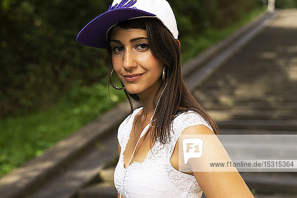 Portrait of young woman with baseball cap