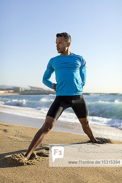 Man doing workout on the beach
