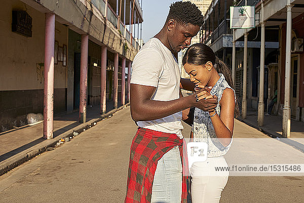 Young couple dancing in the street  Mabuto  Mozambique