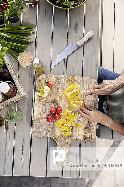 Close-up of woman preparing healthy food outdoors