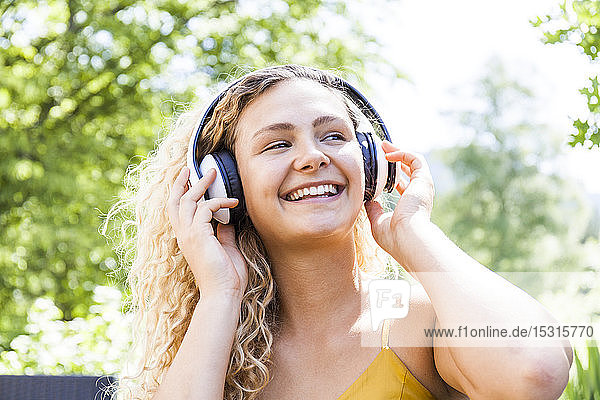 Smiling woman listening to music outdoor