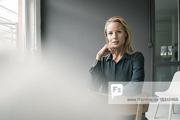 Portrait of successful  blond businesswoman