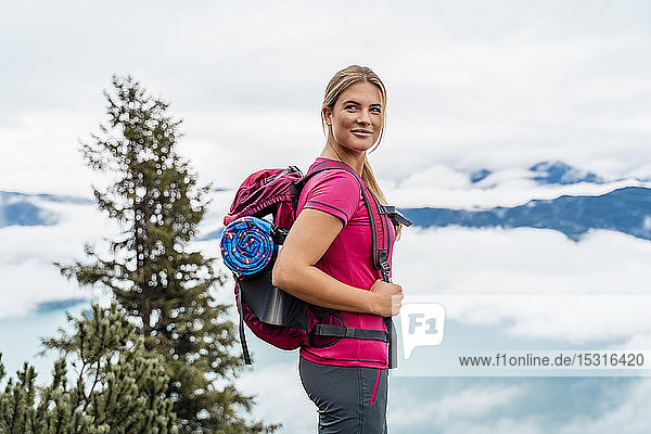 Confident young woman on a hiking trip in the mountains  Herzogstand  Bavaria  Germany