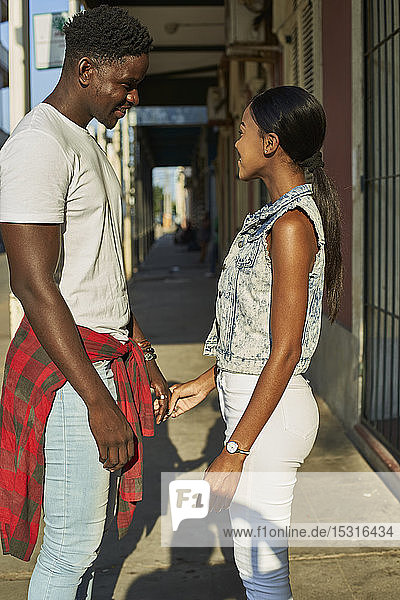 Flirting couple standing in the street in Mabuto  Mozambique