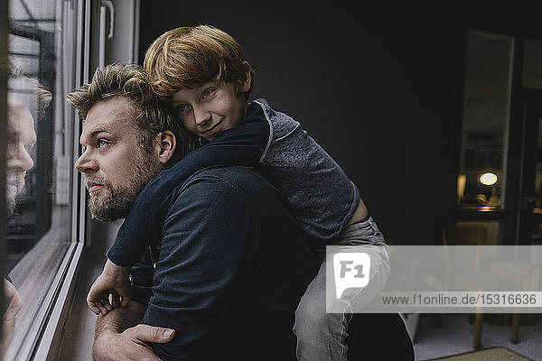 Father and son hanging out at home on rainy day
