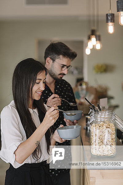 Young couple having breakfast in a cafe