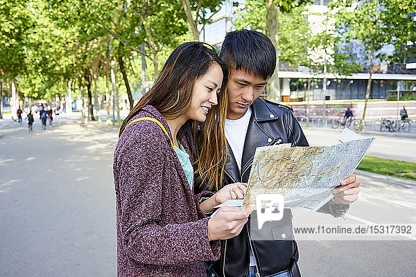 Tourist couple looking at map. Barcelona  Spain