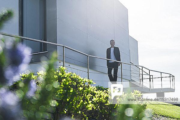 Senior businessman walking outside a building