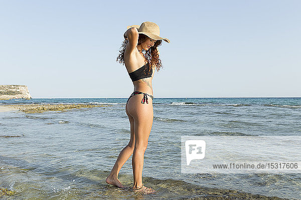 Young woman standing at the beach
