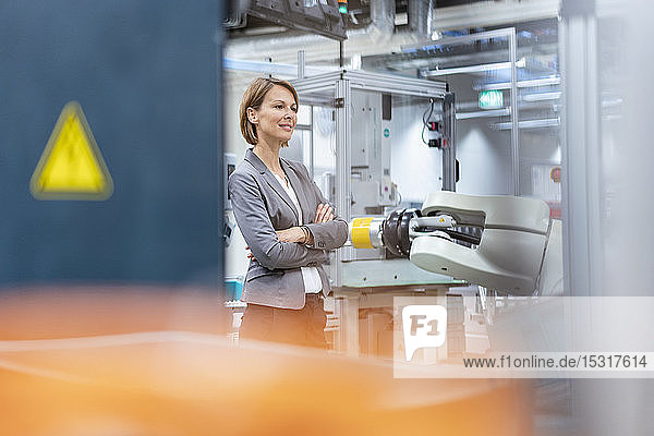 Portrait of a confident businesswoman in a modern factory