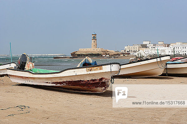 Fishing boats at the beach  Sur Lighthouse in the background  Sur  Oman
