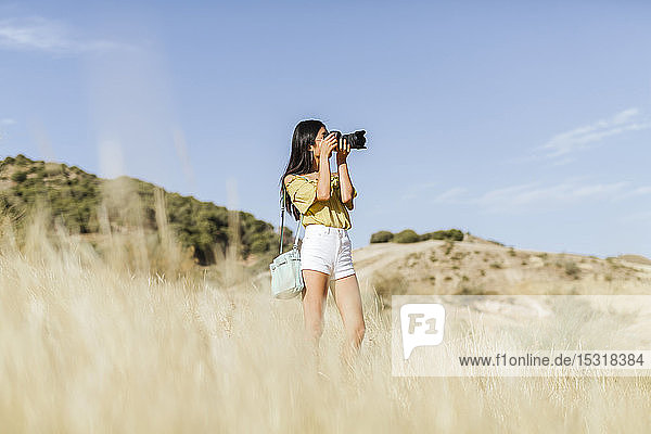 Young woman taking pictures in remote landscape  Granada  Spain