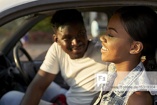 Young couple sitting car  talking