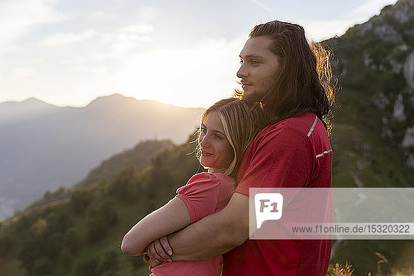 Young couple embracing in the mountains