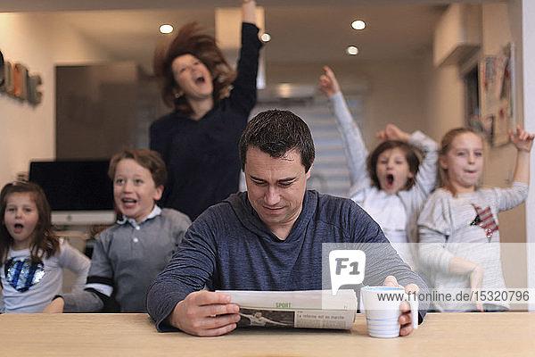 Big family  man reading news
